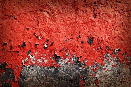 flaky: Grunge texture of cracked red paint on a concrete wall