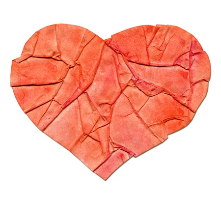 Heart of crumpled paper on a white background. photo