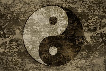 The symbols of yin and yang on grange background texture photo