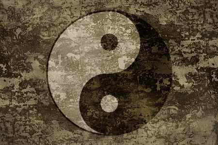 The symbols of yin and yang on grange background texture