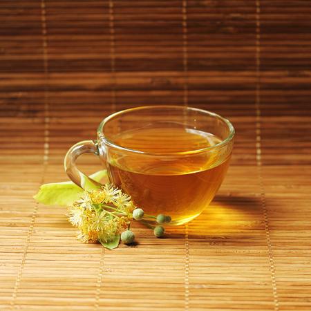 linden tea: Cup with Linden tea. Stock Photo