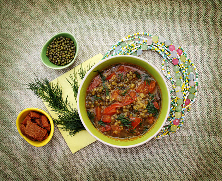 vedic: Vegetarian soup with beans mung bean and tomato. Vedic cooking.