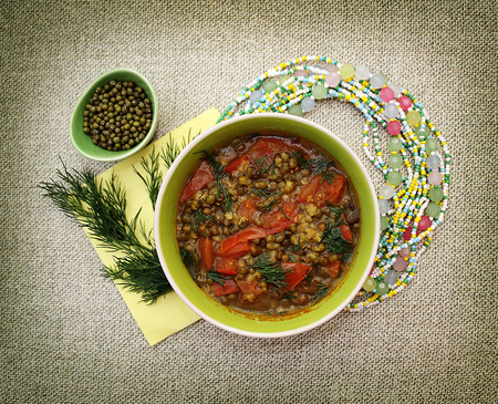 vedic: Vegetarian bean soup mung. Still in the Indian style. Vedic cooking. Stock Photo