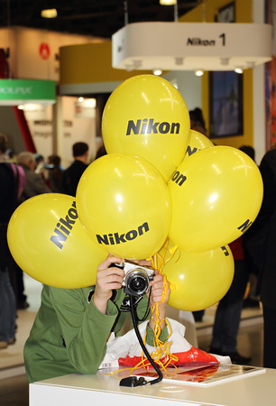 enthusiastically: Moscow, Russia - April 12, 2015: International Exhibition of photography.Forum professionals and photography enthusiasts. Visitor enthusiastically studying camera. Face visitor closed balls Nikon. Editorial