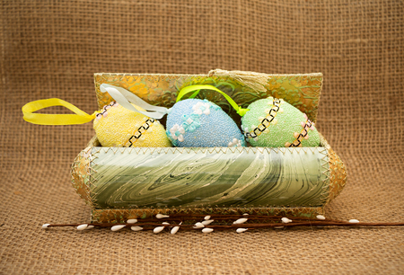 bagging: Easter still-life vintage style. Decorative easter eggs in a box. Stock Photo