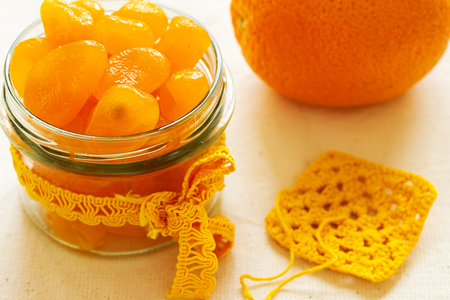 confiserie: Candied kumquat. Candied citrus fruits. Home canning fruit.