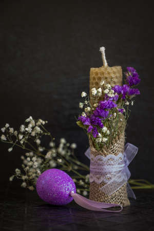 easter candle: Easter candle and a decorative egg. Dark Easter background. Lots of copy space.