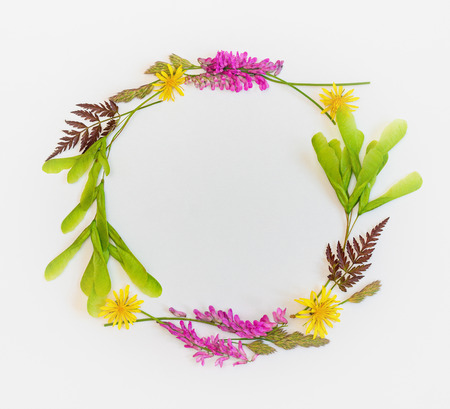 The wreath of wildflowers. Summer frame with wildflowers. Place for a replica. The top view.  Stock Photo