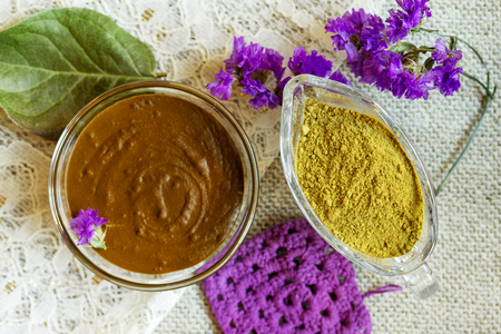 Henna powder and henna paste. Prepare the henna paste at home. Focus on the powder.