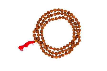 Indian rosary from rudraksha isolated on a white background. 108 beads. Foto de archivo