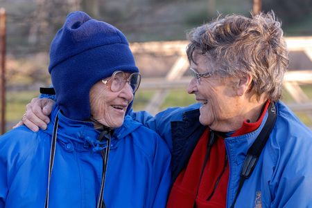 Two old friends laughing and having a good time.