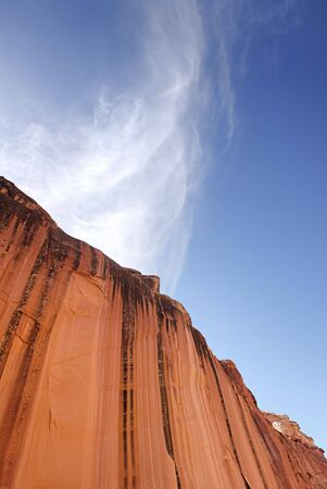 An abstract view of a towering sandstone cliff in the desert of the American southwest.