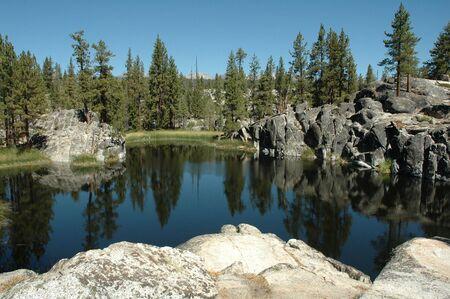 A pristine alpine lake in the western Sierra Nevada Mountains of California.