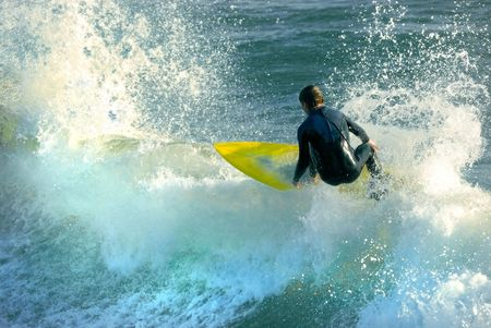 A young surfer boy cuts back on a gorgeous Southern California wave.