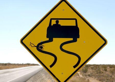A funny but sick sign along a desert highway.