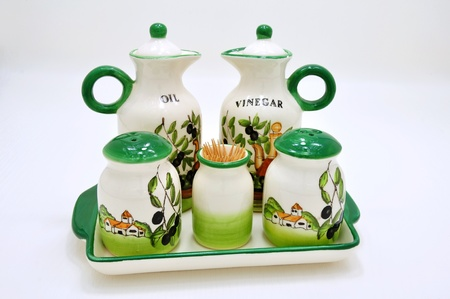 White ceramic container for vinegar, oil, spices and toothpick with beautiful drawings photo