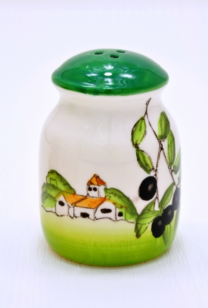 Small ceramic salt shaker with olives and drawing photo