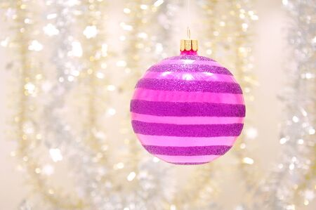Beautiful purple Christmas ornament and Christmas gold and silver chain Stock Photo - 14666690