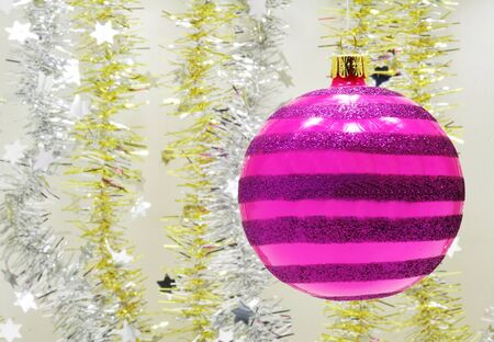 Beautiful purple Christmas ornament and Christmas gold and silver chain Stock Photo - 14666699