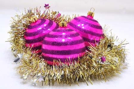 Beautiful purple Christmas ornaments and Christmas gold chain Stock Photo - 14666704