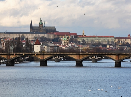 Prague Castle with the Vltava river in winter time photo
