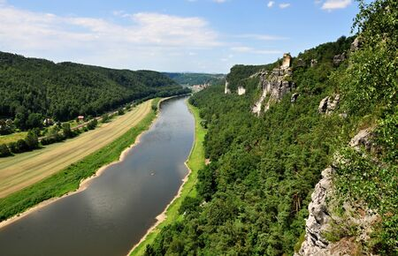 Elbe River flows through beautiful region with rocks and forests
