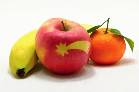 Apple with a star, banana and mandarin with leaves