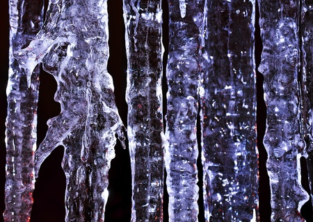 Beautiful blue icicle enlightened cold light in frost Stock Photo - 17630152