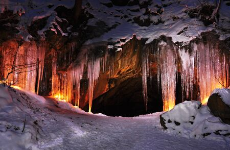 Entrance to ice cave with plenty of icicles Stock Photo - 17630151