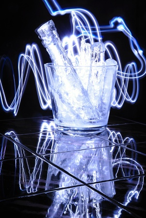 Modern glass jar with pieces of ice and blue light Stock Photo - 17630141