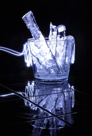 Modern glass jar with pieces of ice and blue light Stock Photo - 17630139