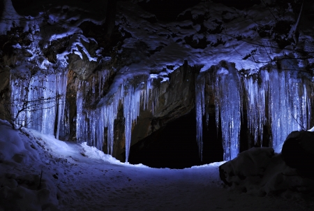 Entrance to ice cave with plenty of icicles Stock Photo - 17630142