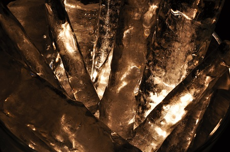 Large pieces of ice in a glass jar on a black background Stock Photo - 17630154