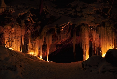 Entrance to ice cave with plenty of icicles Stock Photo