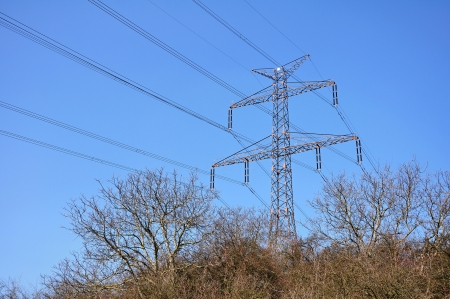 Electrical pylon and wires in the countryside with blue sky Stock Photo - 18766177