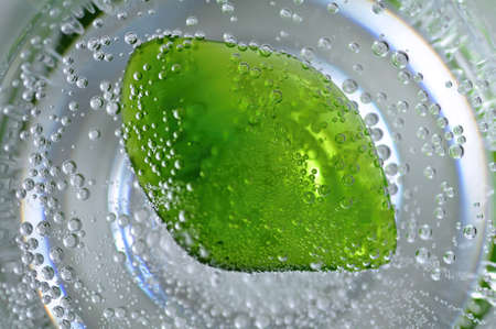 Detail of a small green gemstone in the sparkling water Stock Photo