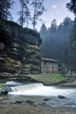 Old Dolsky mill with Kamenice river and fog Stock Photo