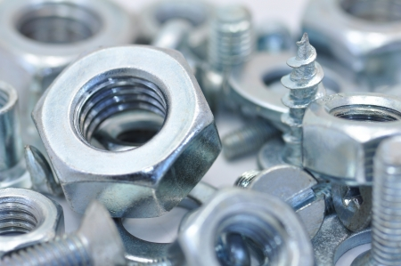 Pile of galvanized steel bolts, nuts and washers