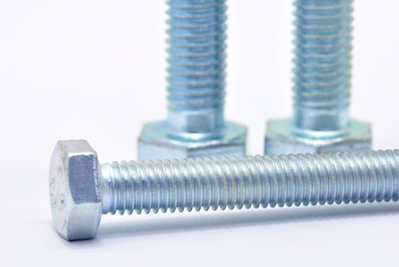 Three galvanized steel screw on a white background  photo