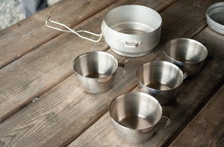 Tin cups for cooking outdoors or camping - For tourists photo