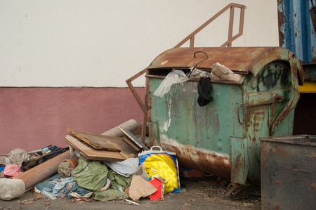 Detailed view of an old container on landfill photo