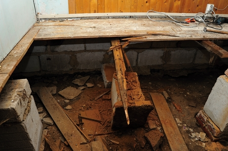 Reconstruction of the severely damaged floor on rural cottage Stock Photo