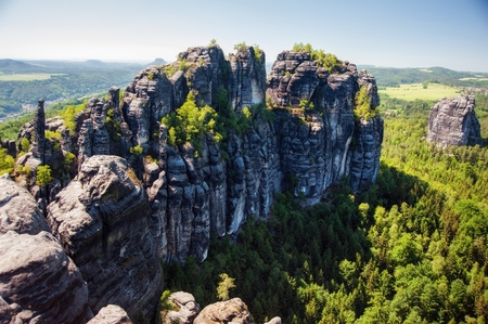 Sandstone rocks, forests and blue sky in the Germany Switzerland Stock Photo