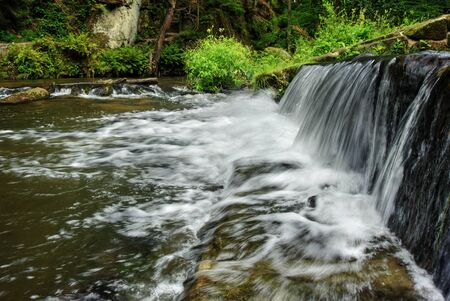 czech switzerland: Weir on the wild river in a forest in Czech Switzerland Archivio Fotografico