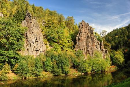enlightened: Rocks enlightened sun on a lazy river in Bohemia