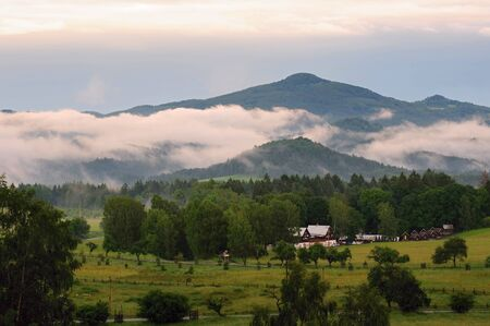 czech switzerland: Czech Switzerland in the evening mist created by rain