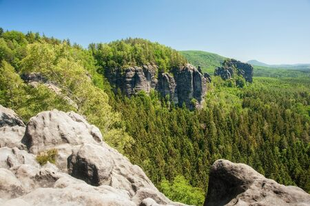 czech switzerland: Sandstone rocks, forests and blue sky in the Czech Switzerland Archivio Fotografico