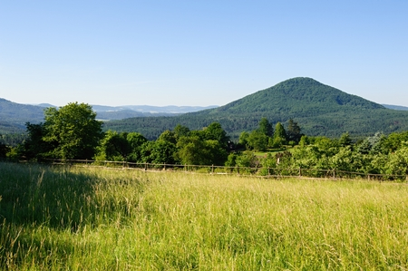 Summer landscape with forests, meadows rocks and sky Stock Photo