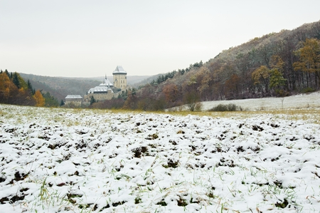 View of a snowy winter landscape with a castle Karlstejn
