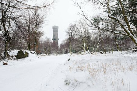 Winter landscape covered with snow and lookout tower Reklamní fotografie